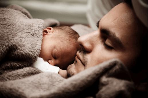 Sleeping newborn on dad
